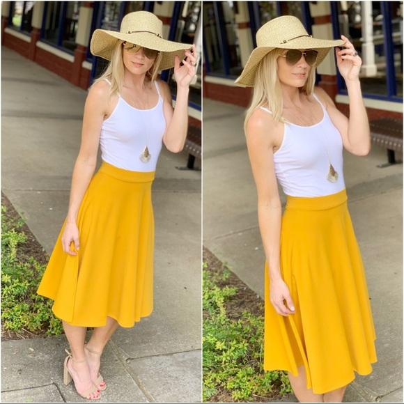 Infinity Raine Dresses & Skirts - Mustard midi skirt